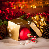 Christmas gifts arranged on a table with spruce branches and lig Stock Photos