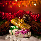 Christmas gifts arranged on a table with spruce branches and lig Royalty Free Stock Photo