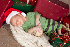 Christmas gifts and a baby Royalty Free Stock Images