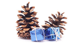 Christmas gifts on the background of spruce cones Stock Image
