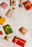 Christmas gifts background. Top view of various wrapped colorful christmas gifts on floor Royalty Free Stock Images