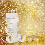 Christmas gifts and balls with gold ribbon Royalty Free Stock Images