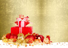 Christmas gifts and balls with gold ribbon Royalty Free Stock Photos