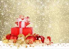 Christmas gifts and balls with gold ribbon Royalty Free Stock Image