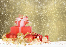 Christmas gifts and balls with gold ribbon Stock Image