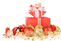 Christmas gifts and balls with gold ribbon Stock Photos
