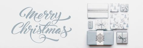 Christmas gifts banner. Beautiful nordic christmas presents isolated on white background. Pastel blue colored wrapped xmas boxes. Gift wrapping concept stock image