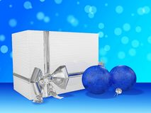 Christmas Gifts and Baubles against Bokeh Royalty Free Stock Images