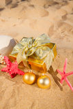 Christmas gifts on beach Stock Images