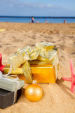Christmas gifts on beach Royalty Free Stock Photo