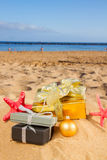 Christmas gifts on beach Royalty Free Stock Photos