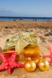 Christmas gifts on beach Stock Image