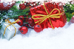 Christmas gifts and berries Royalty Free Stock Image