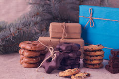 Christmas gifts and biscuits on the background of fir branches. Stock Photography