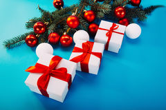 Christmas gifts on blue background Stock Images