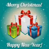 Christmas gifts with bow and ribbon. New Year greeting card. Congratulations On Christmas. Stock Image