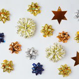 Christmas gifts bows and stars on white background. Stock Image
