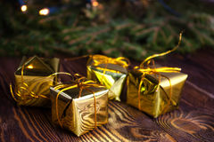 Christmas Gifts box on a background fir branches. Stock Photography