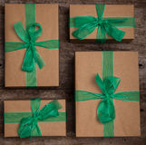 Christmas gifts box presents with brown paper and green ribbon Stock Photos