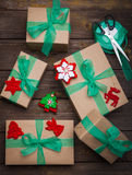 Christmas gifts box presents with brown paper and green ribbon Stock Image