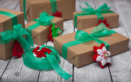 Christmas gifts box presents with brown paper and green ribbon Stock Images