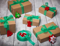 Christmas gifts box presents with brown paper and green ribbon Stock Photography