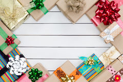 Christmas gifts boxes Border on White Planks Stock Photography
