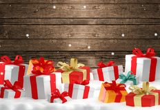 Christmas gifts boxes front of wood winter christmas background. 3d Royalty Free Illustration
