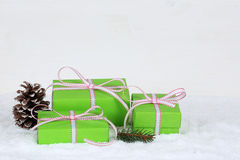 Christmas gifts in boxes with snow on wooden background Stock Photo