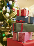 Christmas gifts. Boxes of gifts under christmas tree Stock Images