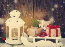 Christmas gifts and candle Royalty Free Stock Photography