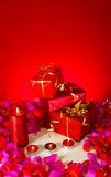 Christmas gifts and candles Stock Photo