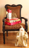 Christmas gifts on a chair Royalty Free Stock Images