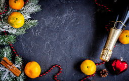 Christmas gifts and champagne with tangerines top view Royalty Free Stock Image
