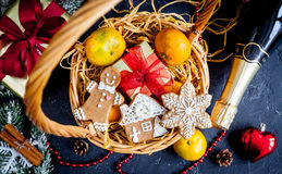 Christmas gifts and champagne with tangerines top view Stock Photo