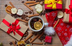Christmas gifts, cinnamon, star anise and cup of tea Stock Image