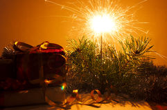 Christmas gifts closeup and bengal sparkler Stock Photo