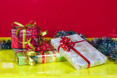 Christmas gifts closeup red and yellow background Stock Photography