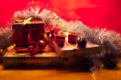 Christmas gifts closeup in a shadow red background Royalty Free Stock Photography