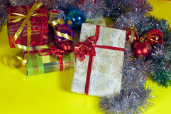 Christmas gifts closeup with yellow background Stock Photos