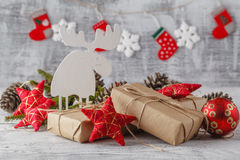 Christmas gifts on color wooden background Stock Images