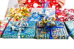 Christmas gifts with colorful packages and ribbons. Closeup of some Christmas gifts with colorful packages and ribbons Royalty Free Stock Images