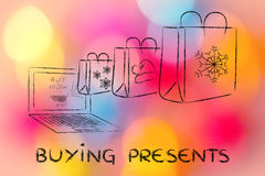 Christmas gifts coming out of a laptop, with text Buying Present Royalty Free Stock Photos