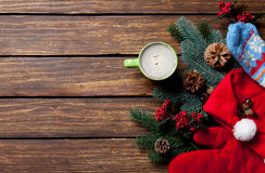Christmas gifts and cup of coffee. On wooden table Royalty Free Stock Photos
