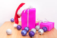 Christmas gifts and decor on table Stock Images