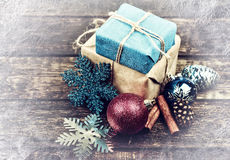 Christmas Gifts Decorated with Linen Cord, Cinnamon, Pine cones,christmas decoration . Vintage Toned image. Snow Drawn. Selective field of focus Stock Image