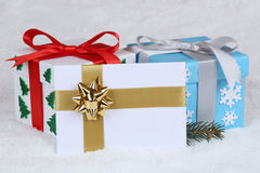 Christmas gifts decoration with envelope and snow Stock Photos