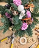 Christmas flower composition. Christmas gifts decoration and making. Festive gift Cardboard boxes, ribbon, fir brunches, cissors. Christmas handmade diy stock photo