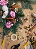 Christmas flower composition. Christmas gifts decoration and making. Festive gift Cardboard boxes, ribbon, fir brunches, cissors. Christmas handmade diy stock photography