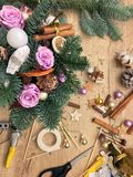 Christmas flower composition. Christmas gifts decoration and making. Festive gift Cardboard boxes, ribbon, fir brunches, cissors. Christmas handmade diy royalty free stock photo